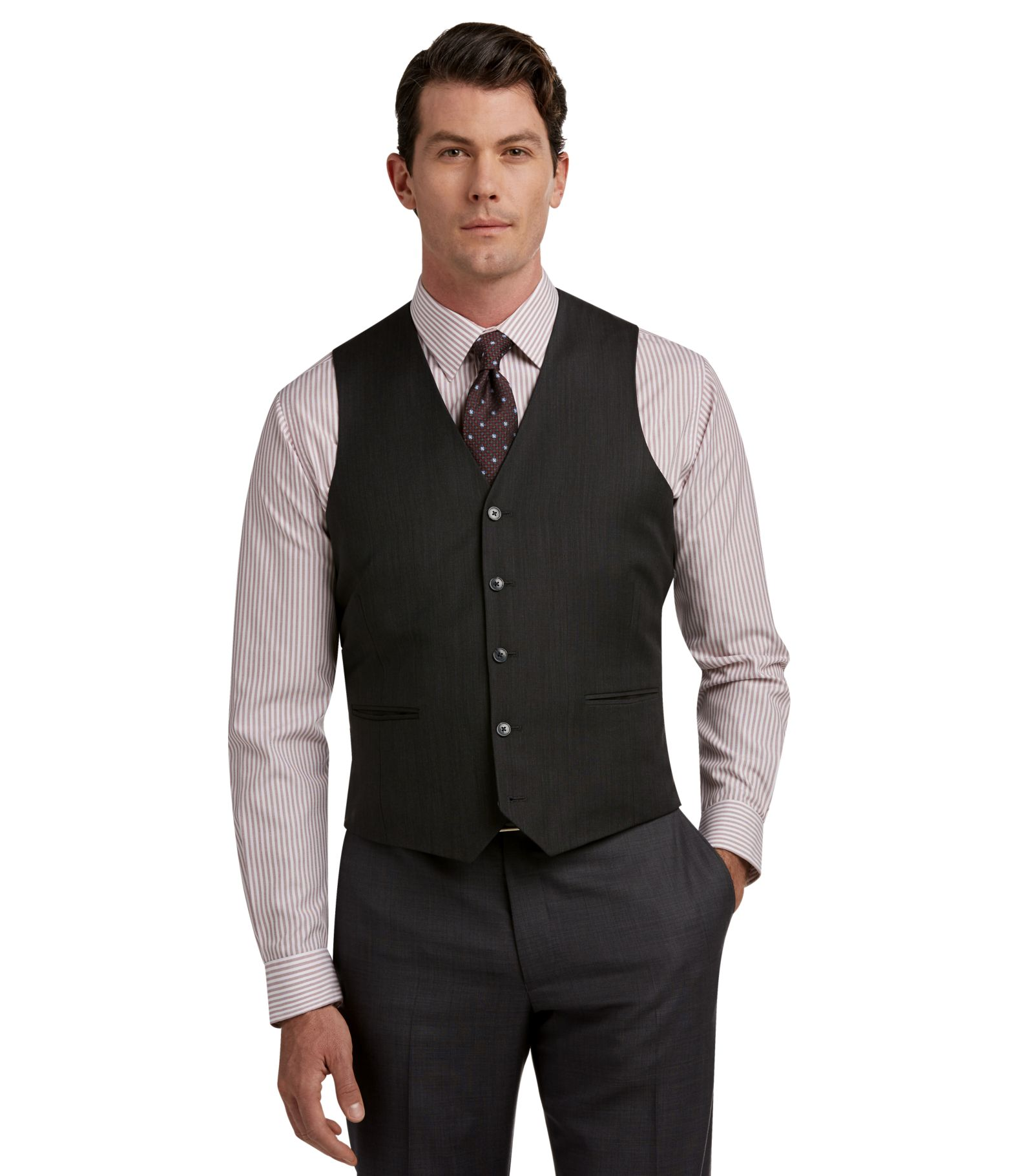 "A well-fitted vest is long enough in the front to cover the man's waist (hence ""waistcoat""), with no dress shirt showing between the belt and the vest. If you're wearing the vest with a suit coat, the V-shape of the vest should be narrower enough that the suit lapels don't hide it entirely."